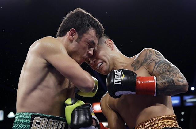 CORRECTS SPELLING OF FIRST NAME TO BRYAN - Julio Cesar Chavez Jr., left, and Bryan Vera butt heads in the second round of a 10-round boxing match between Chavez, the former World Boxing Council (WBC) middleweight champion, and Vera, the contender, in Carson, Calif., Saturday, Sept. 28, 2013. Chavez won in a unanimous decision. (AP Photo/Reed Saxon)