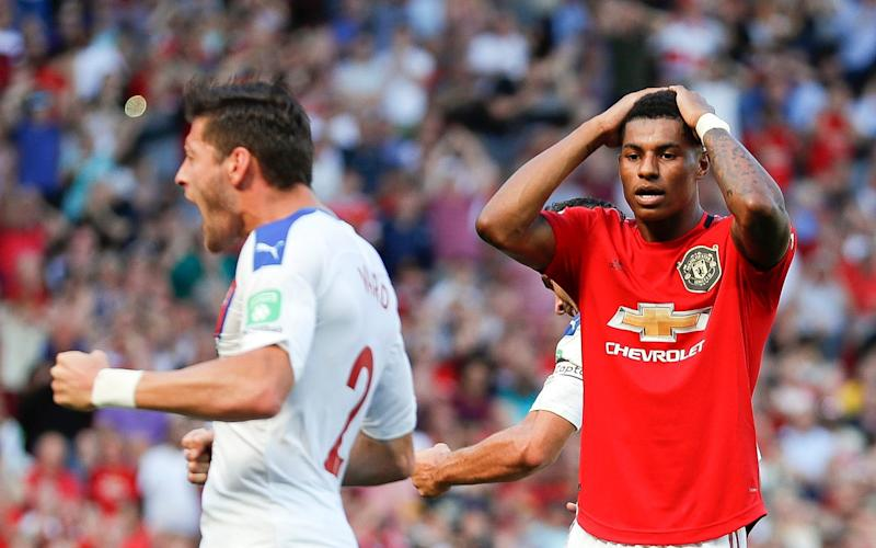 Marcus Rashford reacts after missing to score on a penalty kick  - AP