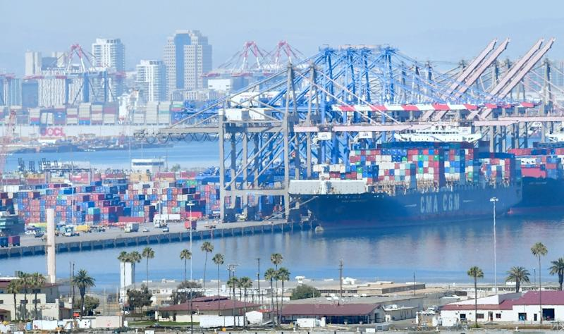 Containers are loaded onto shipping vessels at the Port of Long Beach in California (AFP Photo/Frederic J. BROWN)