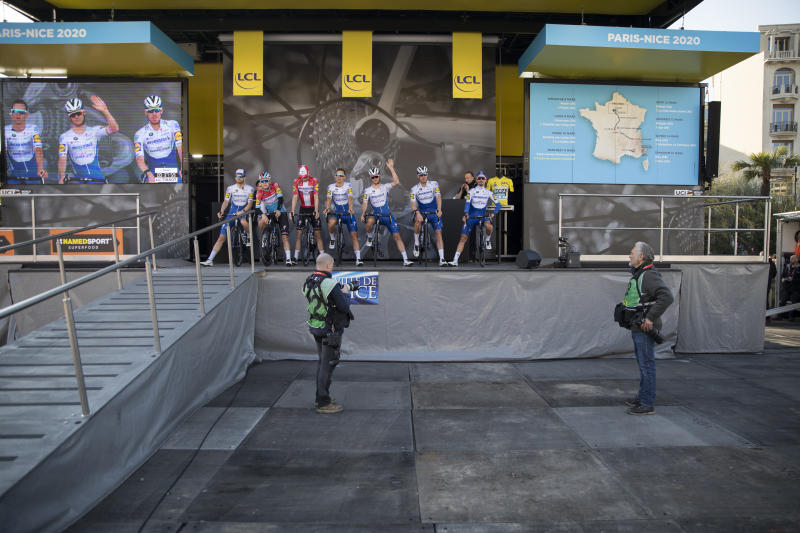 Deceuninck - Quick - Step's Zdenek Stybar, of The Czech Republic, waves as his team is presented to an empty venue in Nice, southern France, before the start of the seventh stage of the Paris Nice cycling race. The eighth and final stage of the event was cancelled and spectators are prevented from attending the race due to measures in place to prevent the spread of the Covid-19 virus. For most people, the new coronavirus causes only mild or moderate symptoms. For some it can cause more severe illness. Stage seven runs just over 166 kilometers starting in Nice and finishing in Valdeblore La Colmiane, France, Saturday, March 14, 2020. (AP Photo/Daniel Cole)