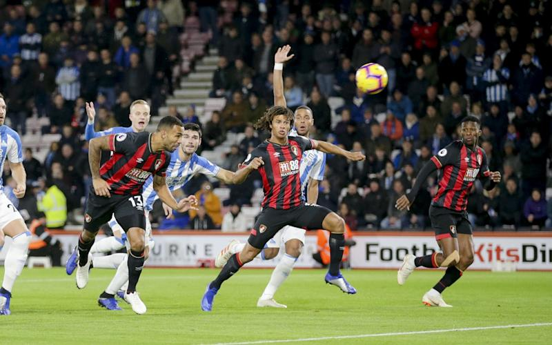Bournemouth back to winning ways and top six as they withstand Huddersfield fightback