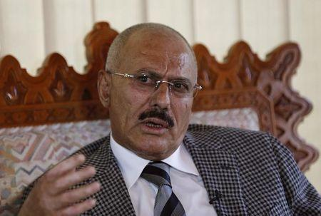 Yemen's former President Ali Abdullah Saleh talks during an interview with Reuters in Sanaa