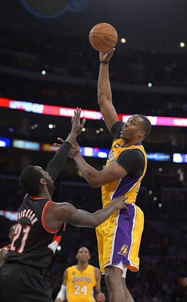 Los Angeles Lakers center Dwight Howard, right, puts up a shot as Portland Trail Blazers center J.J. Hickson defends during the first half of their NBA basketball game, Friday, Feb. 22, 2013, in Los Angeles. (AP Photo/Mark J. Terrill)