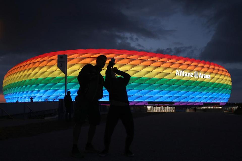 MUNICH, GERMANY - JULY 11: A general view outside of the soccer stadium Allianz Arena which is illuminated in rainbow colours for Christopher Street Day (CSD) on July 11, 2020 in Munich, Germany. Christopher Street Day is an annual European LGBT celebration and demonstration held in various cities across Europe for the rights of LGBT people and against discrimination and exclusion. (Photo by Alexander Hassenstein/Getty Images)