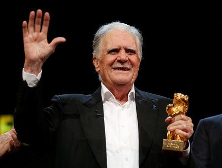 FILE PHOTO: German cinematographer Michael Ballhaus holds an Honorary Golden Bear for his lifetime achievement at the 66th Berlinale International Film Festival in Berlin