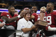 """Alabama players put the """"Old Leather Helmet"""" on head coach Nick Saban after defeating Duke 42-3 in the Chick-fil-A Kickoff NCAA college football, Saturday, Aug. 31, 2019, in Atlanta. (AP Photo/John Bazemore)"""