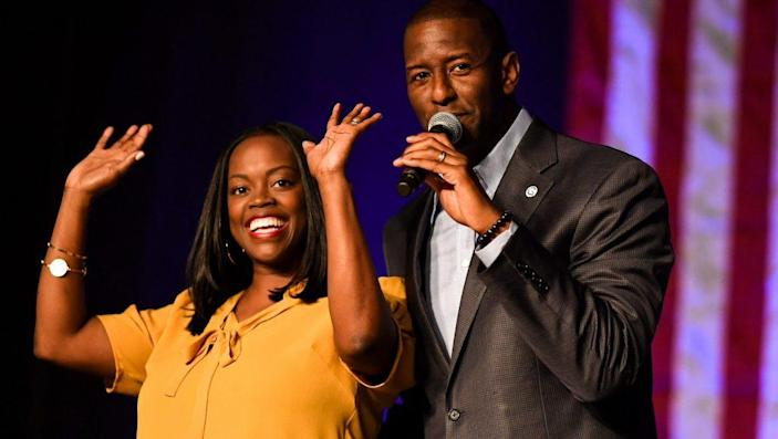 Andrew Gillum is joined by his wife R. Jai Gillum at a campaign rally in the CFE arena on November 3, 2018 in Orlando, Florida. (Photo by Jeff J Mitchell/Getty Images)