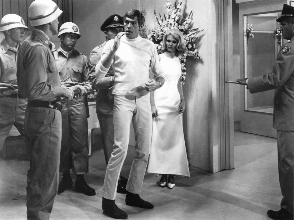 James Coburn and Jean Hale are captured in a scene from the film 'In Like Flint'
