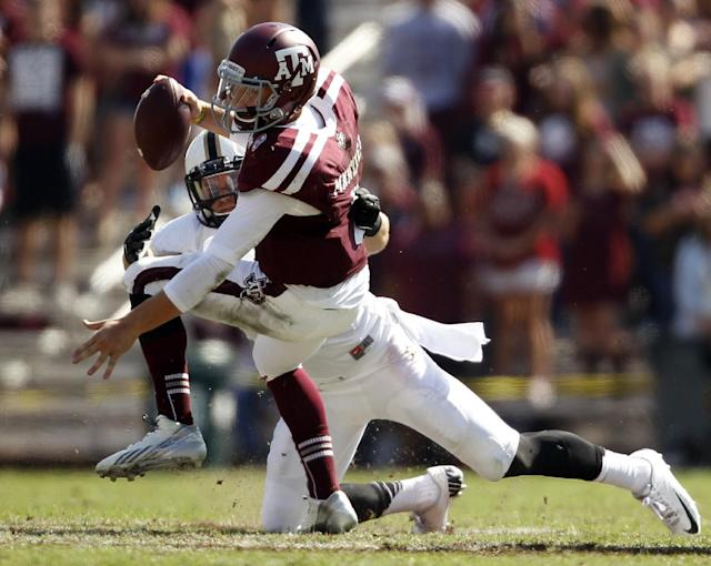 Texas A&M's Johnny Manziel is sacked by Vanderbilt's Kyle Woestmann during the first half of an NCAA football game, Saturday, Oct. 26, 2013, in College Station, Texas. (AP Photo/Eric Christian Smith)