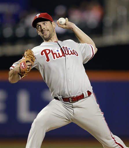 Philadelphia Phillies starting pitcher Cliff Lee delivers against the New York Mets in the second inning of their baseball game at Citi Field in New York, Monday, Sept. 17, 2012. (AP Photo/Kathy Willens)