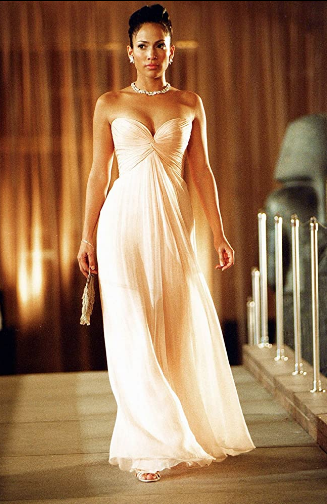 <p>After being mistaken for a wealthy hotel guest, instead of a maid who works in the hotel, Jennifer Lopez's character dons a glamorous sweetheart neckline evening gown in a movie makeover for the ages.</p>