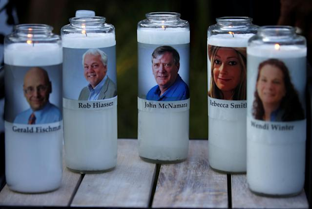 <p>Candles representing the slain journalists of Capital Gazette sit on display during a candlelight vigil held near the Capital Gazette, the day after a gunman killed five people inside the newspaper's building in Annapolis, Md., June 29, 2018. (Photo: Leah Millis/Reuters) </p>