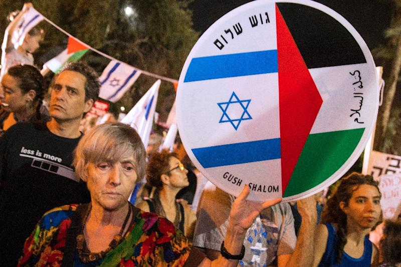 Israeli left-wing activists in Tel Aviv demanded fresh peace talks with Palestinians on the eve of the 20th anniversary of the killing of Prime Minister Yitzhak Rabin and as violence flares (AFP Photo/Jack Guez)