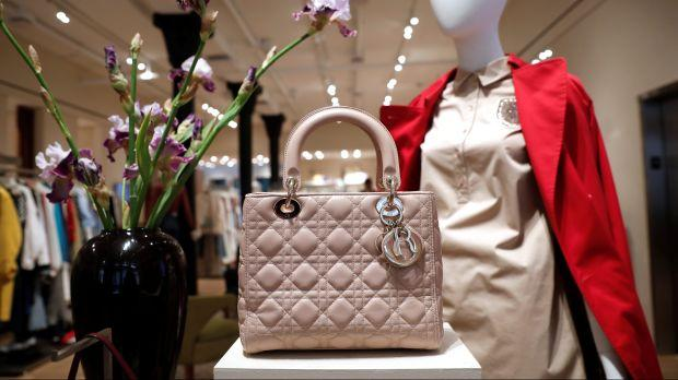 A handbag, jacket, dress, and other items for sale at the RealReal's store in New York