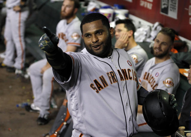 San Francisco Giants' Pablo Sandoval celebrates in the dugout after hitting a pinch-hit home run against the Arizona Diamondbacks during the eighth inning of a baseball game Saturday, May 18, 2019, in Phoenix. (AP Photo/Ralph Freso)