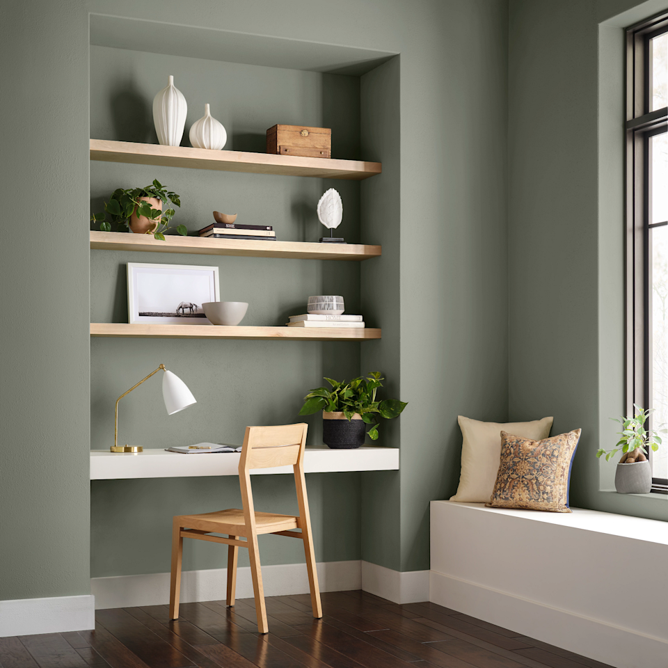 green-gray office with shelves