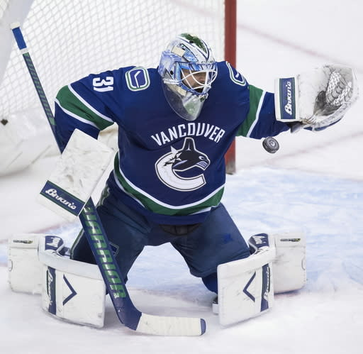 Vancouver Canucks goalie Anders Nilsson, of Sweden, makes a save against the Minnesota Wild during the second period of an NHL hockey game, Tuesday, Dec. 4, 2018, in Vancouver, British Columbia. (Darryl Dyck/The Canadian Press via AP)