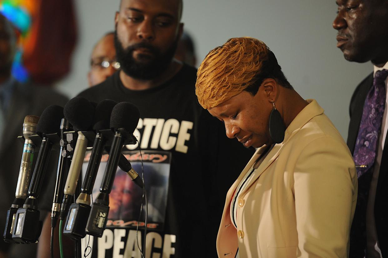 JENNINGS, MO - AUGUST 11: Lesley McSpadden, mother of slain 18-year-old Michael Brown, is overcome with emotion during a press conference at Jennings Mason Temple Church of God In Christ, on August 11, 2014 in Jennings, Missouri. The fatal shooting by police of the unarmed teen in Ferguson, Missouri has sparked outrage in the community and set off civil unrest including looting and vandalism. (Photo by Michael B. Thomas/Getty Images)