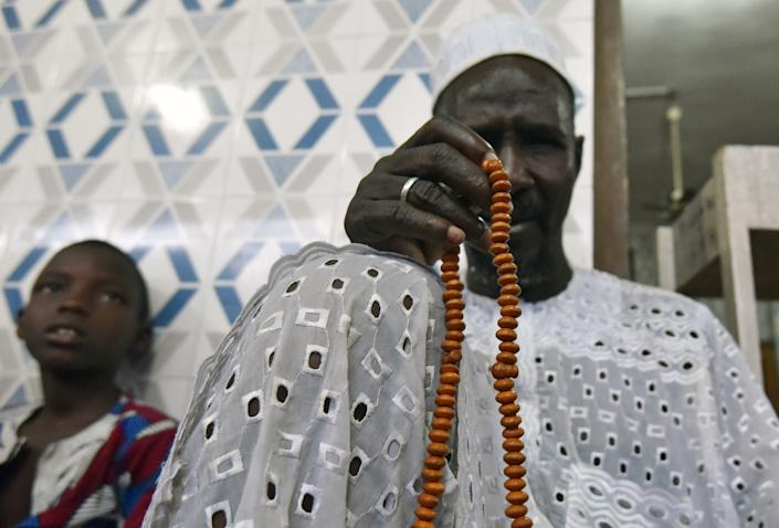 A man prays after breaking his fast on the first day of the holy month of Ramadan on May 27, 2017 at a mosque in Abidjan. The world's nearly 1.5 billion Muslims on May 27 began Ramadan, the holy month of dawn-to-dusk fasting and prayers. It is sacred to Muslims because tradition says the Koran was revealed to the Prophet Mohammed during that month. / AFP PHOTO / Sia KAMBOU (Photo credit should read SIA KAMBOU/AFP/Getty Images)