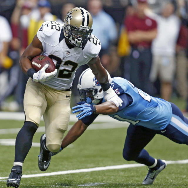 New Orleans Saints running back Mark Ingram (22) carries as Tennessee Titans free safety George Wilson tries to tackle in the first half of a NFL preseason football game in New Orleans, Friday, Aug. 15, 2014. (AP Photo/Rogelio Solis)