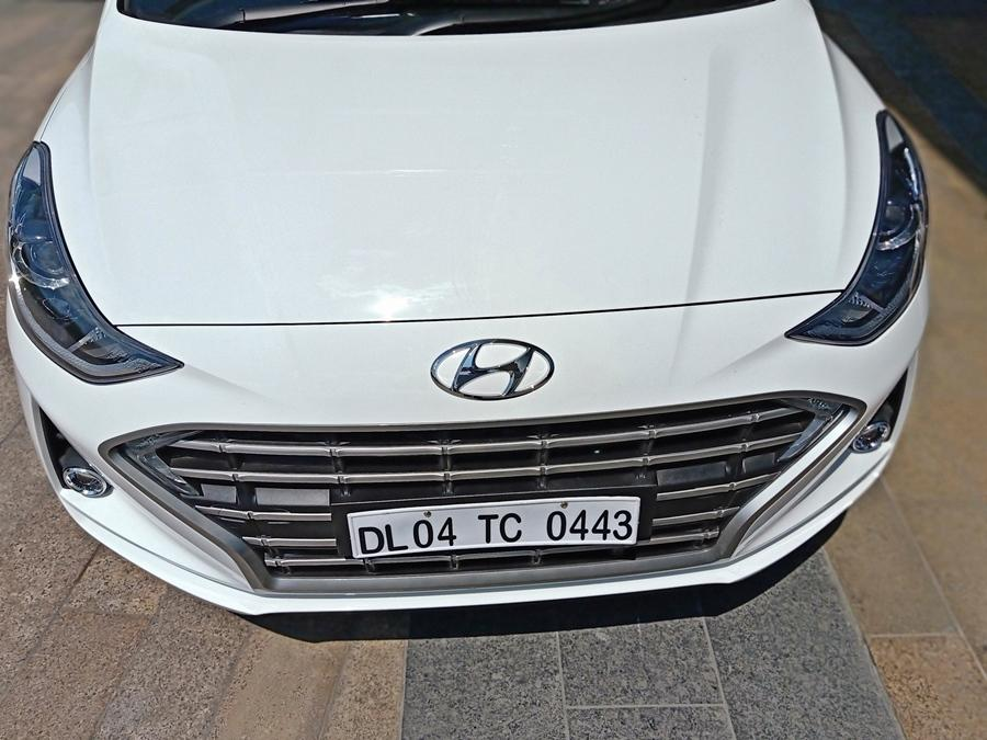 It is longer, wider and sleeker over the current Grand i10. Design-wise it is certainly the sharpest hatch from Hyundai. Do not miss those LED DRLs on the edges of the grille.