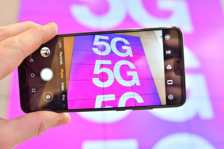 The fifth generation or 5G mobile networks will offer super-fast data transfer for technologies such as self-driving cars and remotely operated factory robots (AFP Photo/Justin TALLIS)