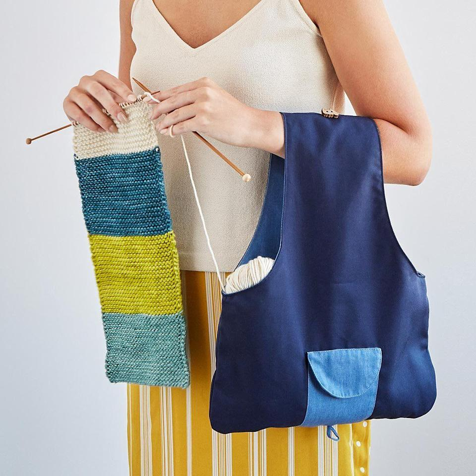 """<p><strong>Uncommon Goods</strong></p><p>uncommongoods.com</p><p><strong>$35.00</strong></p><p><a href=""""https://go.redirectingat.com?id=74968X1596630&url=https%3A%2F%2Fwww.uncommongoods.com%2Fproduct%2Ftravel-knitting-bag&sref=https%3A%2F%2Fwww.goodhousekeeping.com%2Fholidays%2Fgift-ideas%2Fg34205721%2Fbest-gifts-for-knitters%2F"""" rel=""""nofollow noopener"""" target=""""_blank"""" data-ylk=""""slk:Shop Now"""" class=""""link rapid-noclick-resp"""">Shop Now</a></p><p>Since she's mastered the basics, she can stitch just about anywhere, especially if she has this knitting bag on her arm. It's the perfect size to store three balls of yarn, spare needles, and other accessories. </p>"""