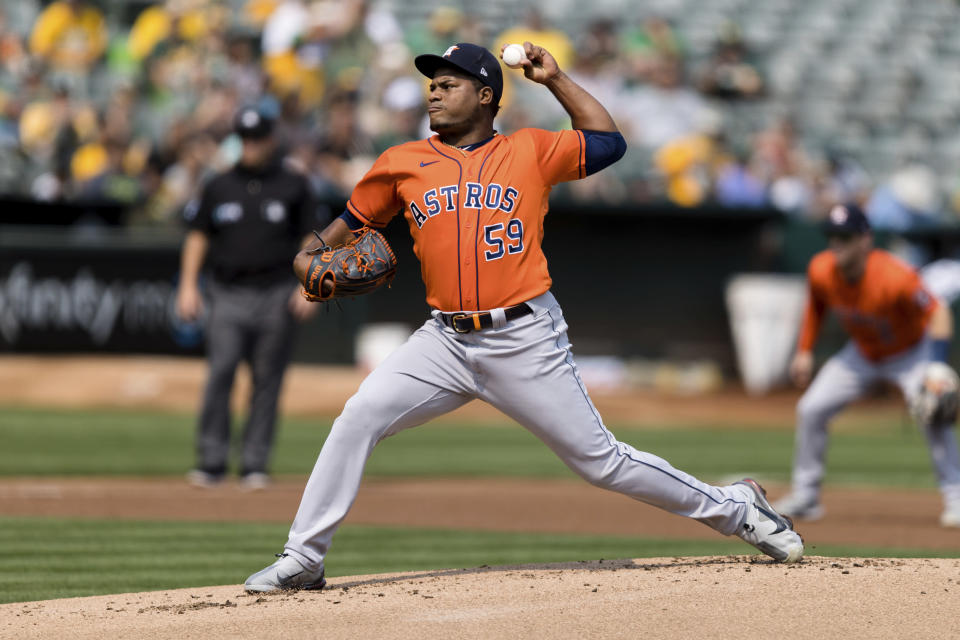Houston Astros starting pitcher Framber Valdez works against the Oakland Athletics in the first inning of a baseball game in Oakland, Calif., Saturday, Sept. 25, 2021. (AP Photo/John Hefti)