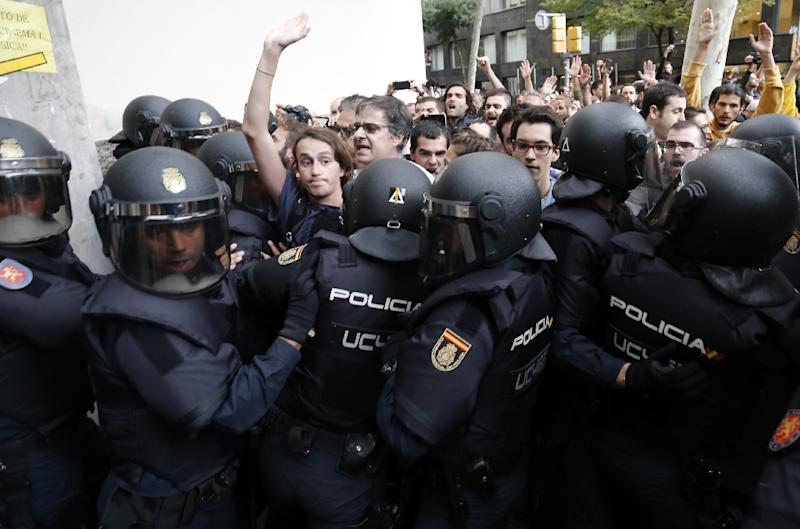 Rights groups say police used excessive force to try and stop the Catalan referendum in October (AFP Photo/PAU BARRENA)