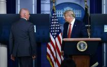 US President Donald Trump was abruptly ushered out of a press conference by secret service agents, and later said that a person had been shot outside the White House