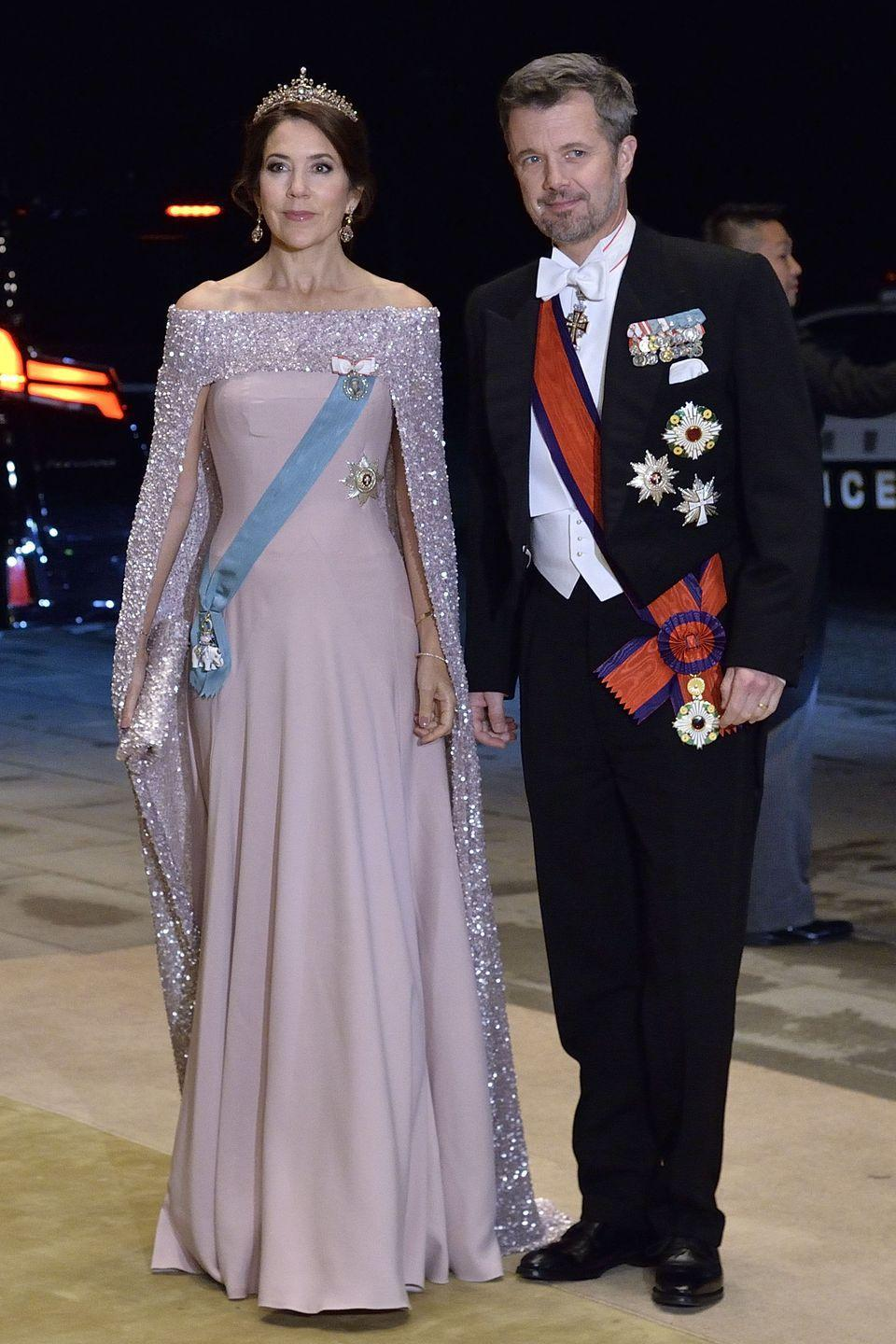 <p>That same weekend, Crown Princess Mary wore another lilac cape dress, though this one featured sequin detailing. She and Crown Prince Frederik attended a court banquet at Tokyo's Imperial Palace. This event called for even more formal attire, as Mary swapped out her hat for a tiara. <br></p>