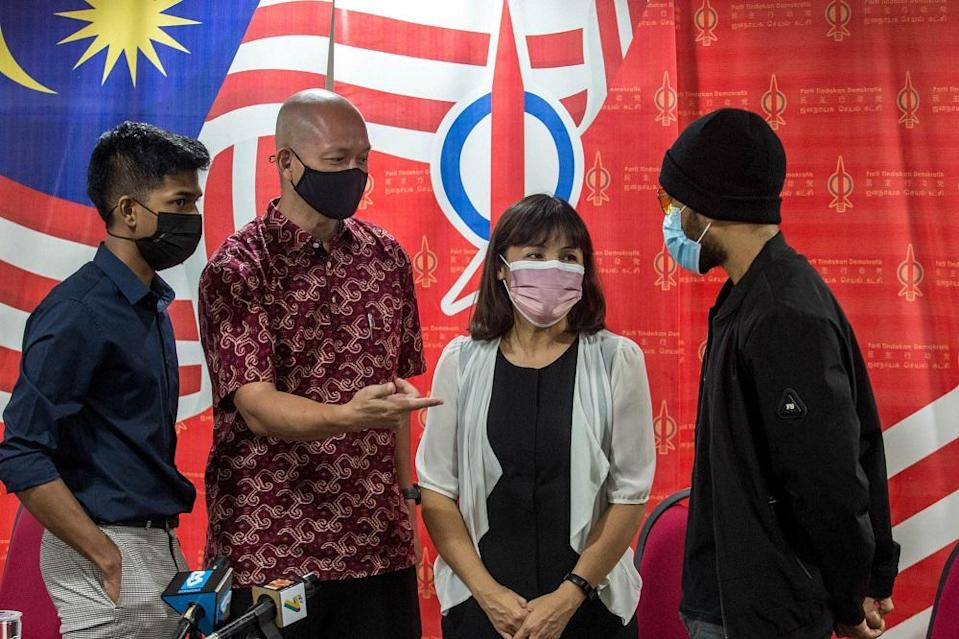 Kulai MP Teo Nie Ching (second right) speaks to a LimKokWing University student after a press conference in Kuala Lumpur May 3, 2021. — Picture by Firdaus Latif