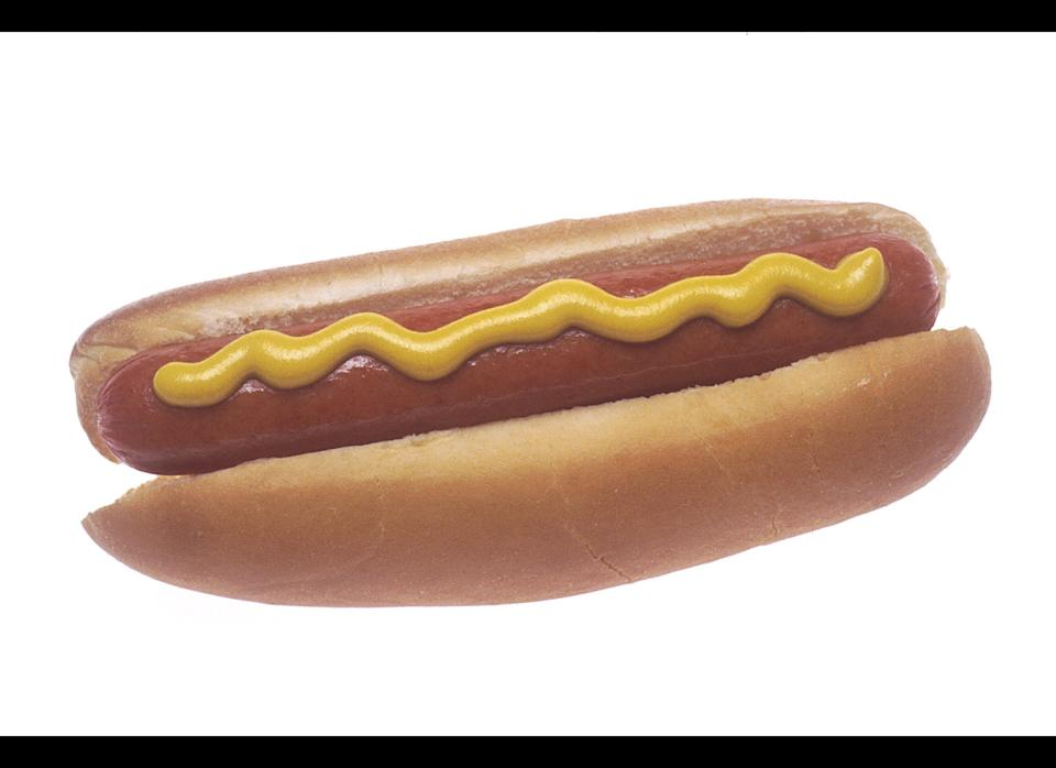 """No one said hot dogs promote longevity, but it's not like eating a frankfurter is as dangerous as someone sticking a gun in your face --unless your name is Olivia Chaines and you're eating it at Costco. The then-31-year-old had <a href=""""http://www.clickorlando.com/news/3274884/detail.html"""" target=""""_hplink"""">swallowed a piece of a Hebrew National brand hotdog</a> in the shopping aisle of a Costco in May 2004 before she realized that it contained a piece of metal. X-rays revealed that the hot dog had contained a live bullet."""