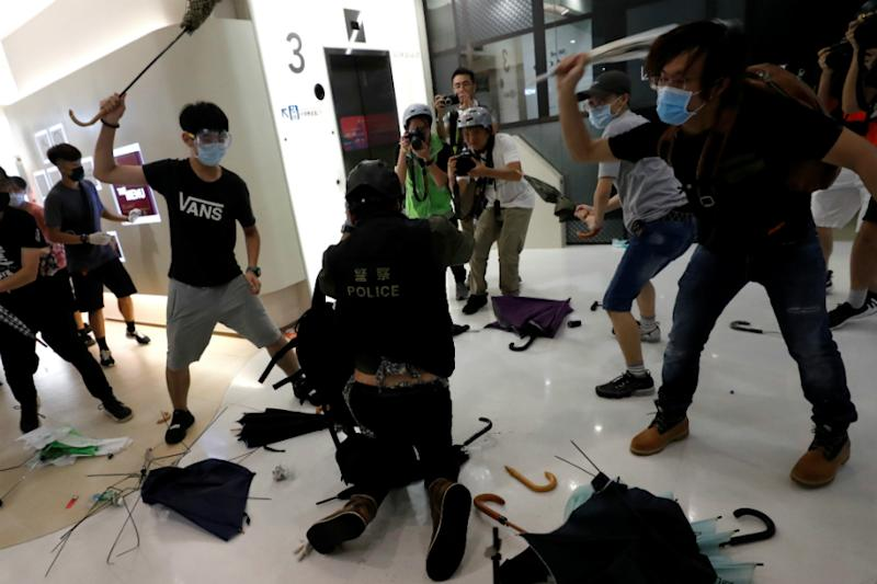 Hong Kong Extradition Protesters Hurl Umbrellas, Plastic Bottles at Cops as Fear Grips Suburbs
