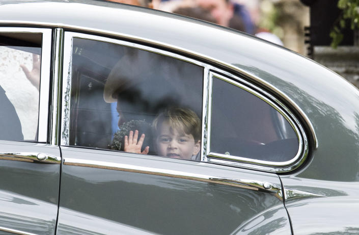 The royal found time for a quick wave during the wedding. (Arthur Edwards)