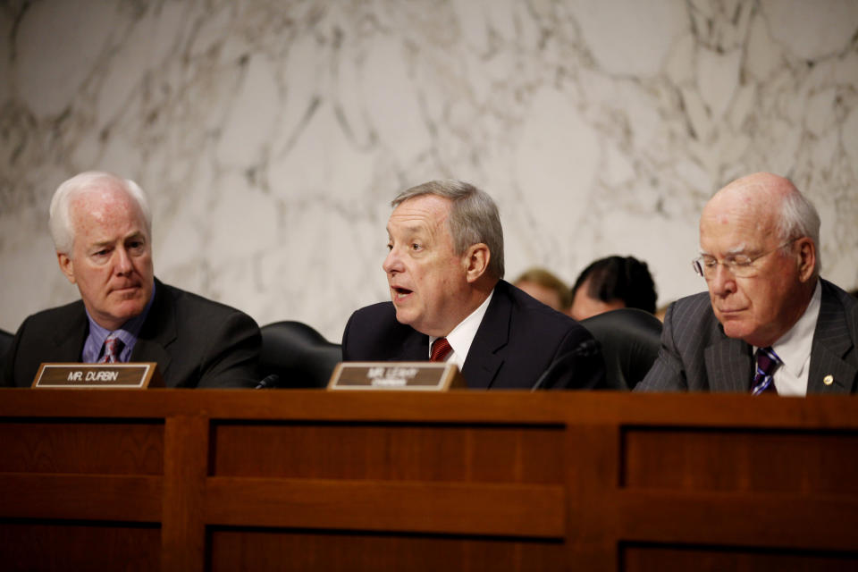 """FILE - In this Tuesday, June 28, 2011 file photo, Sen. Richard Durbin, D-Ill., center, flanked by Sen. John Cornyn, R-Texas, left, and Sen. Patrick Leahy, D-Vt., speaks during a meeting on Capitol Hill in Washington. The Senate holds its second hearing Tuesday, Feb. 12, 2013, on gun curbs since the December 2012 shooting deaths of 20 first-graders in Newtown, Conn. This time, a Senate Judiciary subcommittee is examining the constitutionality and effectiveness of federal firearms limits. """"We need to keep guns out of the hands of criminals and those who are mentally unstable,"""" Durbin, D-Ill., said in a brief interview Monday, Feb. 11, 2013. """"I hope everyone will acknowledge what within our Constitution is not only an individual right to bear arms, but the collective right of Americans to be safe."""" (AP Photo/Charles Dharapak, File)"""