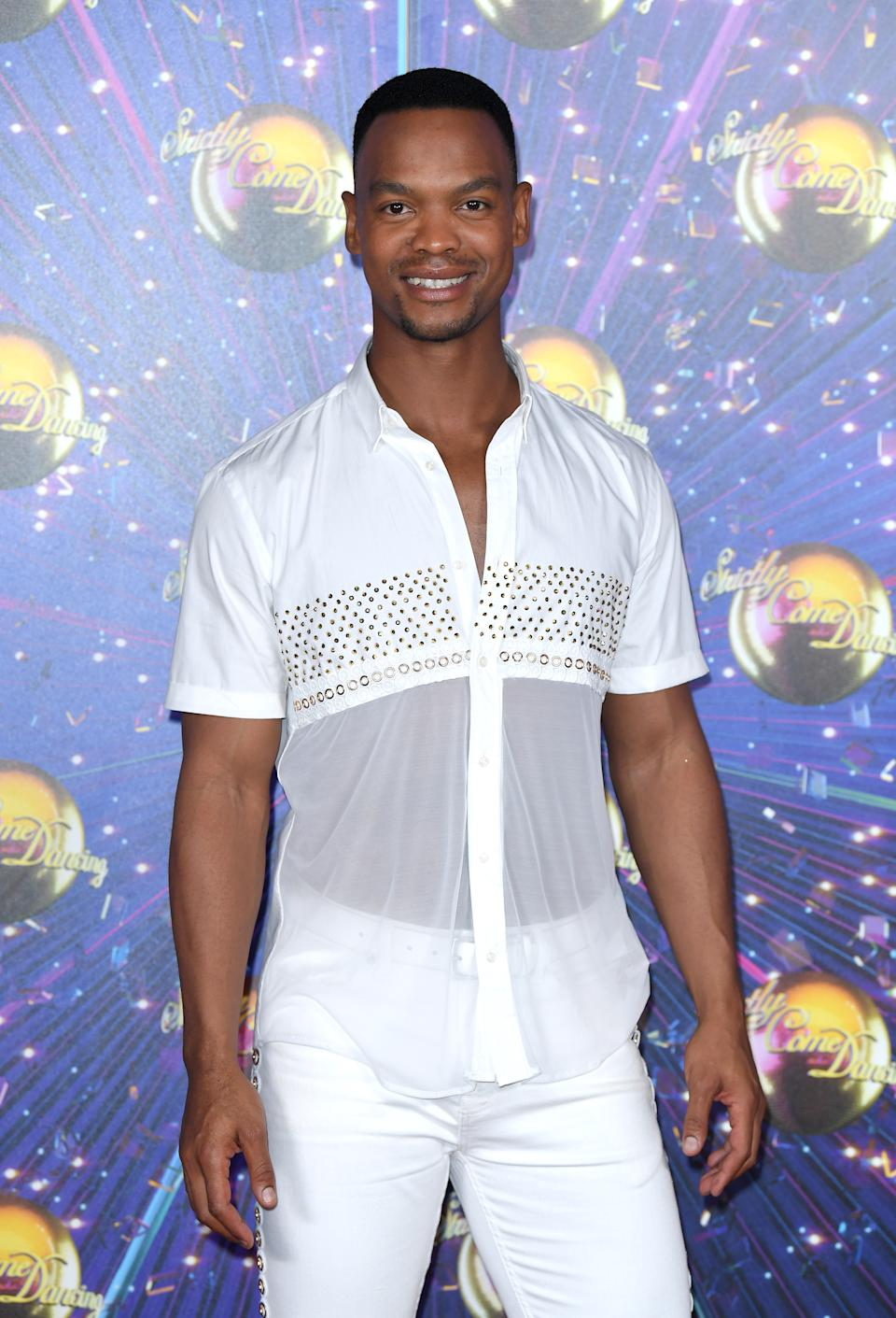 """LONDON, ENGLAND - AUGUST 26: Johannes Radebe attends the """"Strictly Come Dancing"""" launch show red carpet arrivals at Television Centre on August 26, 2019 in London, England. (Photo by Karwai Tang/WireImage)"""