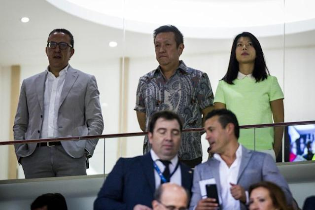 Singaporean businessman and owner of Valencia CF Peter Lim (top C) attends the UEFA Champions League playoff football match between Valencia CF vs AS Monaco FC at the Mestalla Stadium in Valencia on August 19, 2014