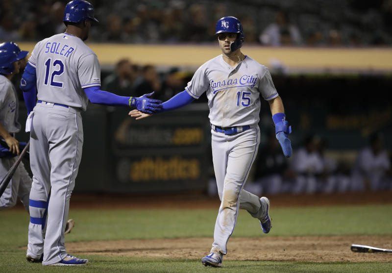 Kansas City Royals' Whit Merrifield, right, celebrates with Jorge Soler (12) after scoring the game-winning run against the Oakland Athletics in the ninth inning of a baseball game Monday, Sept. 16, 2019, in Oakland, Calif. (AP Photo/Ben Margot)