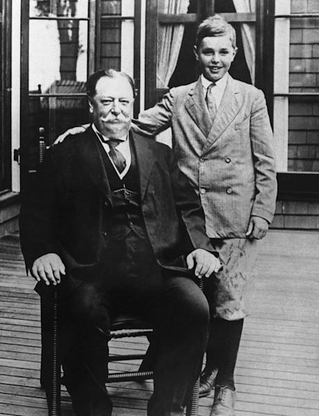 FILE - This file photo shows President William Howard Taft with his son Charles while on vacation in Beverly, Mass. History buffs know Taft is the only president to later become Supreme Court chief justice, but he's also remembered as the president whose weight, at times well over 300 pounds, made headlines. Yet in the early 1900s, way before Weight Watchers, the nation's 27th president was helping to usher in a modern approach to treating obesity according to a report released Monday, Oct. 14, 2013, in the journal Annals of Internal Medicine. (AP Photo/File)