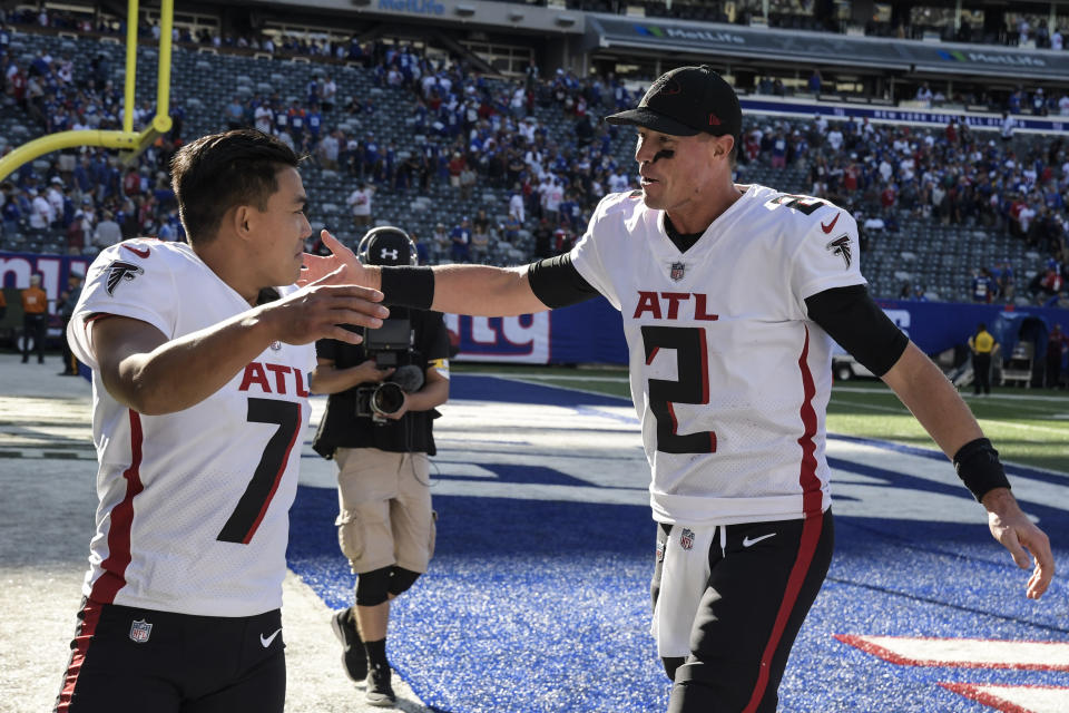 Atlanta Falcons kicker Younghoe Koo (7) and quarterback Matt Ryan (2) celebrate after their win over the New York Giants after an NFL football game, Sunday, Sept. 26, 2021, in East Rutherford, N.J. (AP Photo/Bill Kostroun)