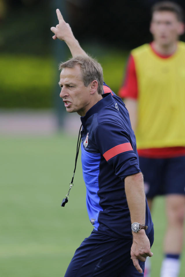 Head coach of the United States soccer team, Jurgen Klinsmann, from Germany, leads his team's training session in Sao Paulo, Brazil, Tuesday, Jan. 14, 2014. The US national soccer team is on a training program to prepare for the World Cup tournament that starts in June. (AP Photo/Nelson Antoine)