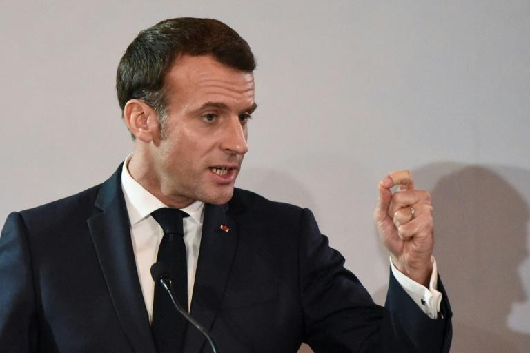 French President Emmanuel Macron, on a visit to Ivory Coast, appealed for a holiday truce (AFP Photo/SIA KAMBOU)