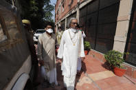 Acharya Dharmendra Dev, an accused in the 1992 attack and demolition of a 16th century mosque, leaves for a court in Lucknow, India, Wednesday, Sept. 30, 2020. An Indian court on Wednesday acquitted all 32 accused, including four senior leaders of the ruling Hindu nationalist Bharatiya Janata Party, in the case. The demolition sparked Hindu-Muslim violence that left some 2,000 people dead. (AP Photo/Rajesh Kumar Singh)