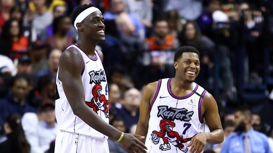 Pascal Siakam #43 and Kyle Lowry #7 of the Toronto Raptors share a laugh during a break in play.  (Photo by Vaughn Ridley/Getty Images)
