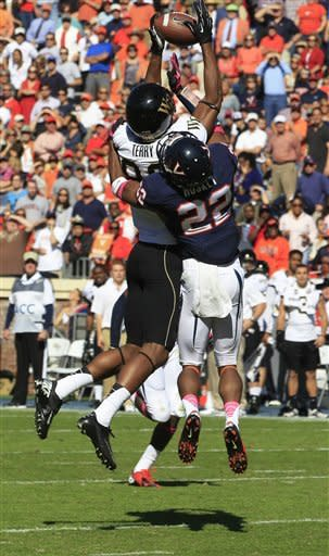 Wake Forest wide receiver Brandon Terry (86) hauls in a pass near the goal line in front of Virginia cornerback Drequan Hoskey (22) during the first half of a NCAA college football game at Scott Stadium in Charlottesville, Va., Saturday, Oct. 20, 2012. (AP Photo/Steve Helber)