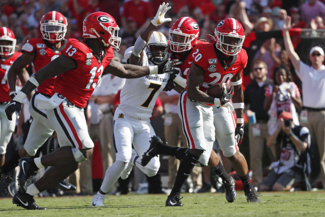 Georgia defensive back J.R. Reed (20) runs for a touchdown after recovering a Murray State fumble in the first half of an NCAA college football game Saturday, Sept. 7, 2019, in Athens, Ga. (AP Photo/John Bazemore)