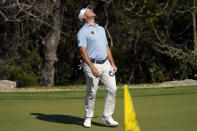 Lee Westwood, of England, reacts to a missed birdie putt on the first hole of a playoff against Sergio Garcia, of Spain, during a third round match at the Dell Technologies Match Play Championship golf tournament Friday, March 26, 2021, in Austin, Texas. (AP Photo/David J. Phillip)