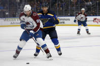 Colorado Avalanche's Andre Burakovsky (95) controls the puck in front of St. Louis Blues' Jaden Schwartz (17) during the third period in Game 3 of an NHL hockey Stanley Cup first-round playoff series Friday, May 21, 2021, in St. Louis. (AP Photo/Scott Kane)