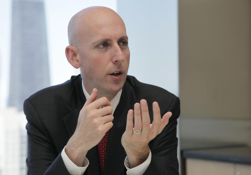 FILE - In this June 4, 2012, file photo, former assistant United States Attorney Reid Schar speaks during an interview at the office of his law firm Jenner & Block in Chicago. Schar, who served 13 years as as an assistant U.S. attorney, was the lead prosecutor in former Illinois Gov. Rod Blagojevich's corruption trial. On Wednesday, Jan. 15, 2014, the New Jersey Assembly tapped Schar as special counsel to advise a legislative committee plot that shut down lanes to the George Washington Bridge for four days in September. (AP Photo/M. Spencer Green, File)